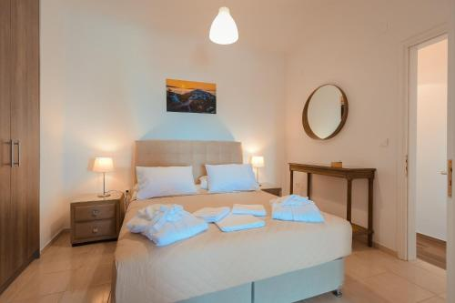 A bed or beds in a room at Lazarou Beach Apartments