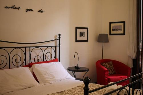 A bed or beds in a room at Casa Barbero Charme B&B