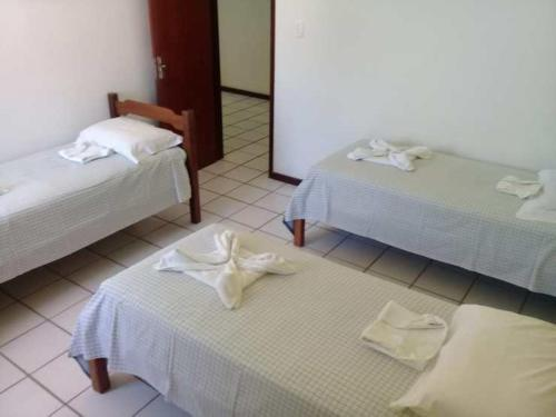 A bed or beds in a room at CTL - Itaparica