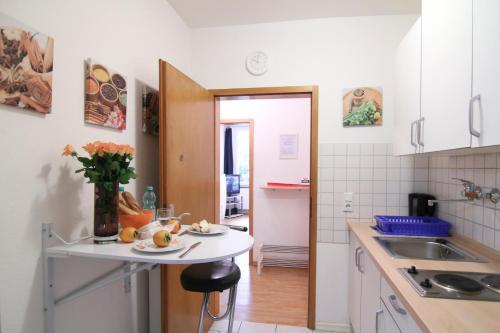 Кухня или мини-кухня в Apartmondo Ferienwohnungen
