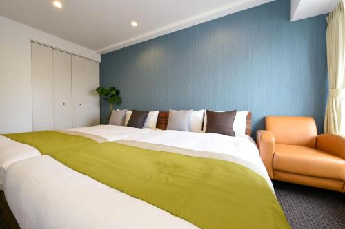 A bed or beds in a room at Residence Hotel Stripe Sapporo