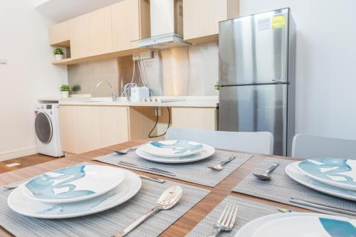 A kitchen or kitchenette at ClubHouse Residences Elm Attic Studio Suites (Staycation Approved)