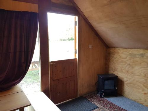 A bed or beds in a room at Bell Tent Glamping