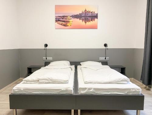 A bed or beds in a room at Dominik Panzió