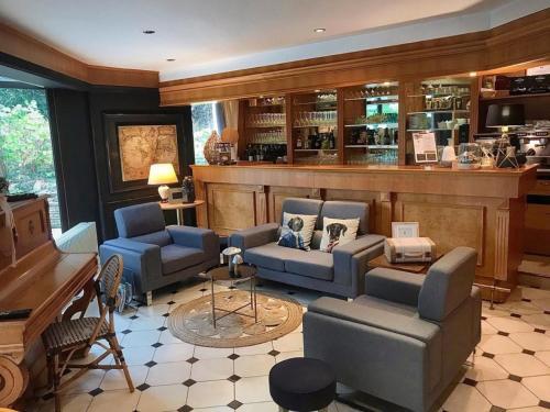 """The lounge or bar area at AUBERGE de """"L'Hostellerie le Saint Laurent"""" - Hotel Restaurant - Institut de """"Bien etre"""" et ses """"Appart Hotel"""""""