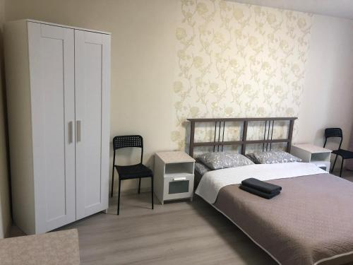 A bed or beds in a room at Apartment on Kashirskoye shosse 108k1