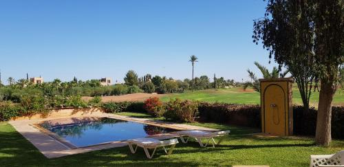 The swimming pool at or near Villa Le Golf