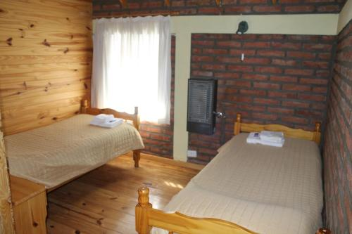 A bed or beds in a room at Los Teros