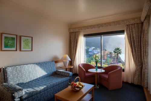 Uma área de estar em Monte Mar Palace Hotel