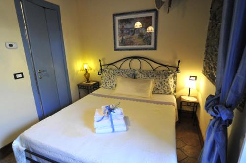 A bed or beds in a room at Affittacamere Le Terrazze