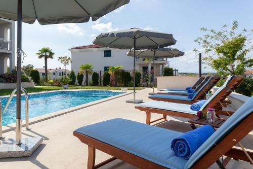 The swimming pool at or close to Luxury apartments Vila Carissa
