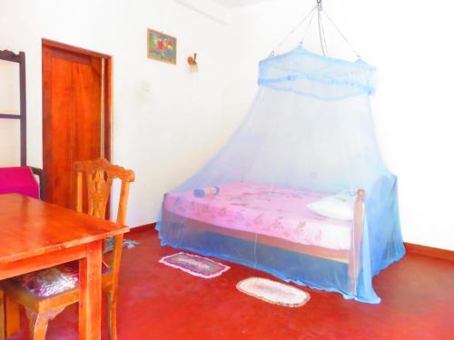 Ein Bett oder Betten in einem Zimmer der Unterkunft Beach Lagoon Guesthouse
