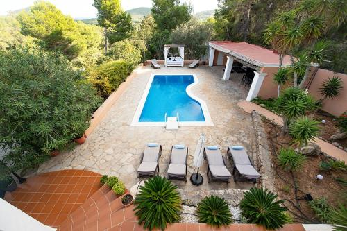 A view of the pool at Villa Mercedes or nearby