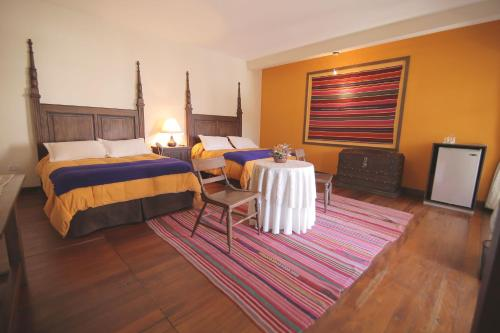 A bed or beds in a room at Mi Pueblo Samary Hotel Boutique