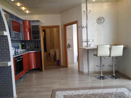 A kitchen or kitchenette at Уютная квартира с прекрасным видом на море