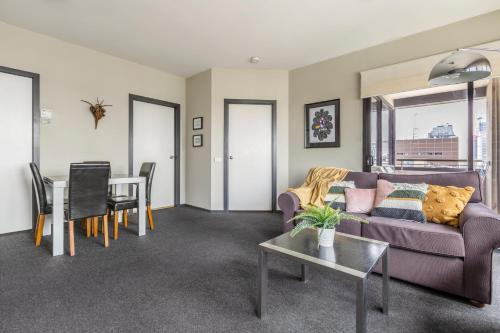 A seating area at BIG SIZE 2BR + CAR = HEART OF MELBOURNE CBD