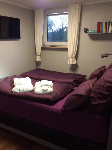 Postel nebo postele na pokoji v ubytování Ferienwohnung Mahlsdorf-Ein Quäntchen mehr