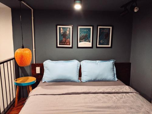 A bed or beds in a room at Mai Homestay Côn Đảo