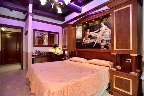 Un ou plusieurs lits dans un hébergement de l'établissement Hotel Pantheon