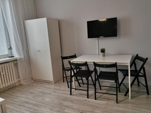 A television and/or entertainment centre at Apartment J&B