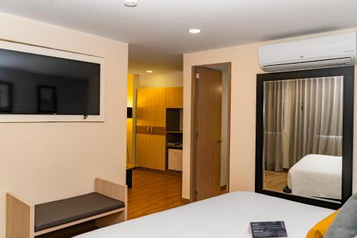 A bed or beds in a room at Hotel Casino Internacional by Sercotel