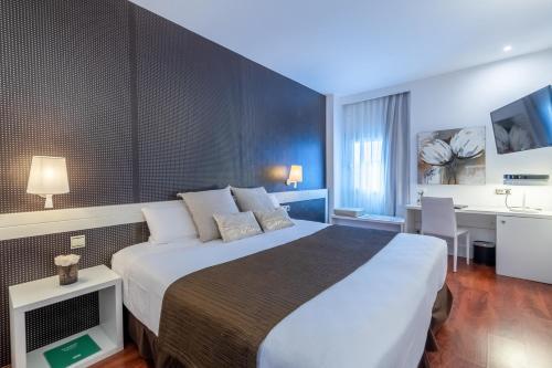 Un ou plusieurs lits dans un hébergement de l'établissement Amura Alcobendas
