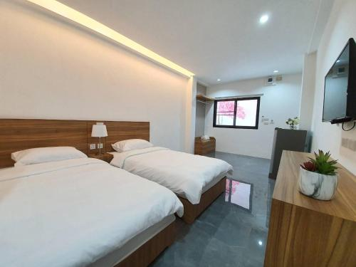A bed or beds in a room at April 11 Residence