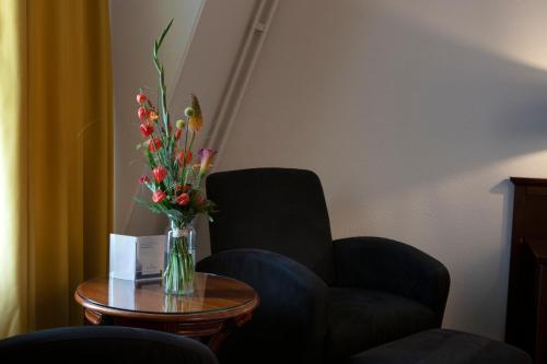 Een zitgedeelte bij Golden Tulip L'Escaut Terneuzen