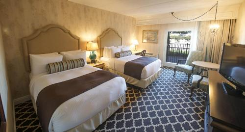 A bed or beds in a room at Molly Pitcher Inn