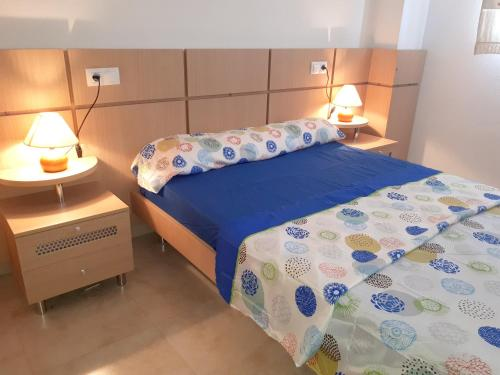 A bed or beds in a room at Apartment Av. Central - 2