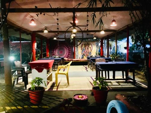 A restaurant or other place to eat at The Lungi Vibe