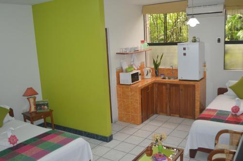 A kitchen or kitchenette at Nativa Apartments