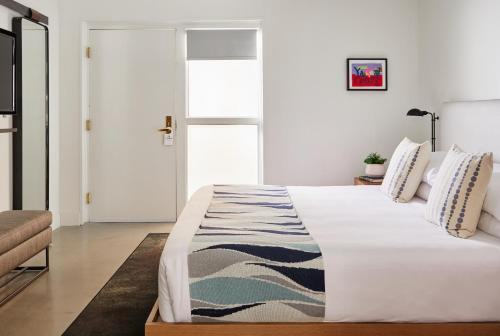 A bed or beds in a room at The Downtowner