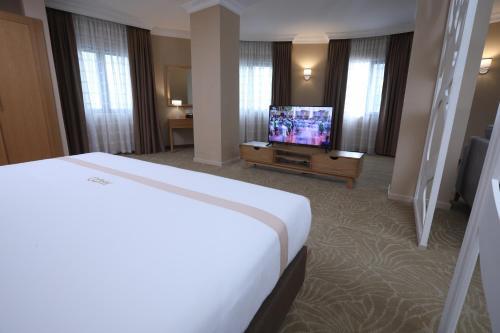 Mado Hotelにあるベッド