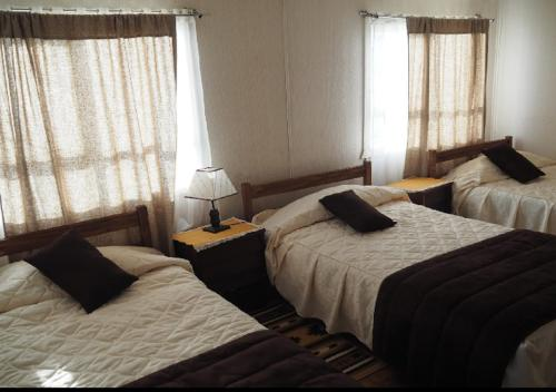 A bed or beds in a room at Hostal Beraca