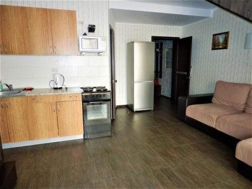 A kitchen or kitchenette at Bungalo in Bannoye