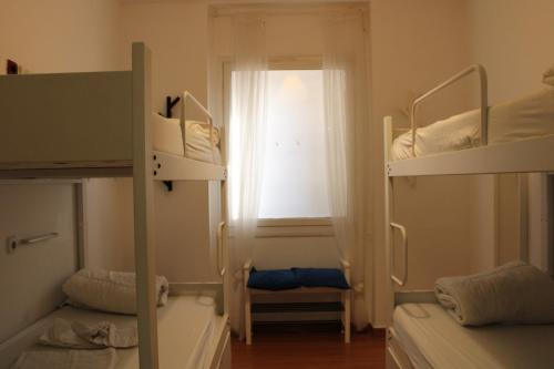 A bunk bed or bunk beds in a room at Mediterranean Hostel Barcelona