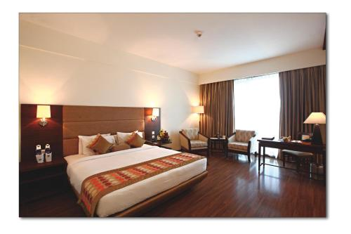 A bed or beds in a room at Country Inn & Suites By Radisson - Amritsar