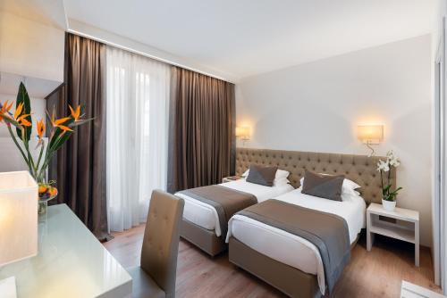 Letto o letti in una camera di Hotel Villa Costanza ***S