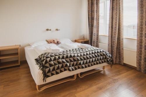 A bed or beds in a room at Framtid Apartments and Holiday Homes