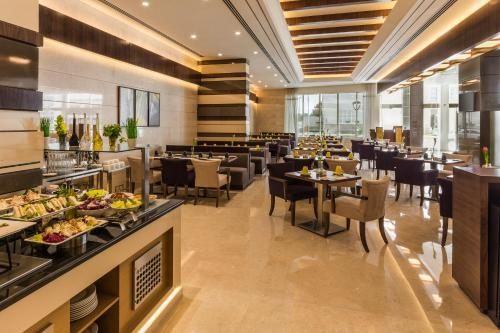 A restaurant or other place to eat at Golden Tulip Media Hotel