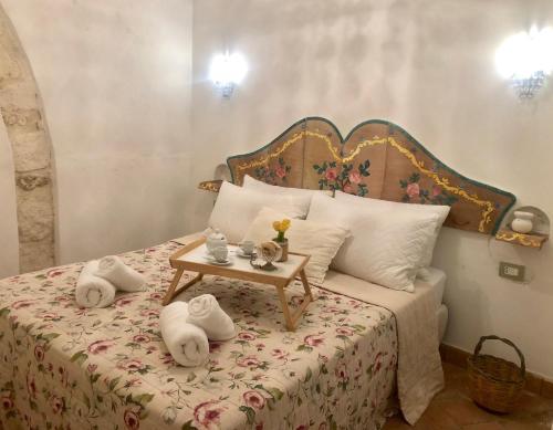 מיטה או מיטות בחדר ב-Il Dammuso dei Sogni