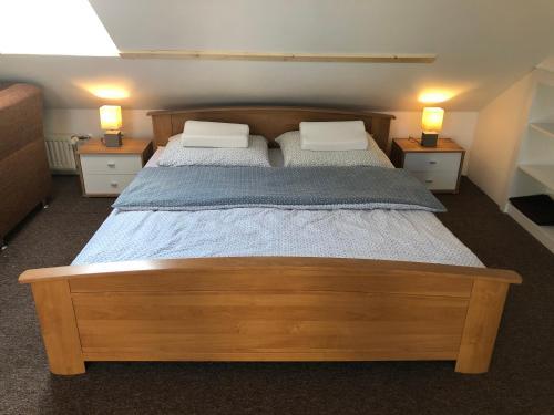 Postel nebo postele na pokoji v ubytování NRC Apartments