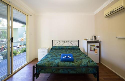 A bed or beds in a room at Kipara Tropical Rainforest Retreat
