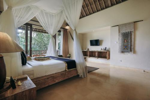 A bed or beds in a room at The Sankara Resort by Pramana