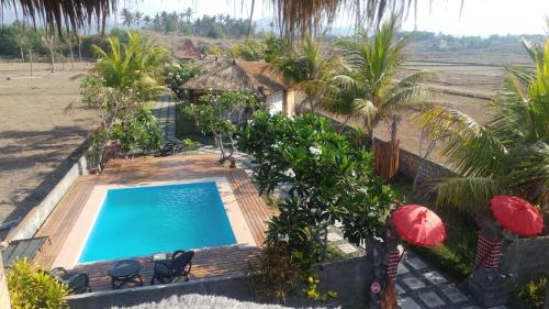 A view of the pool at Bali Tiger Hideaway or nearby