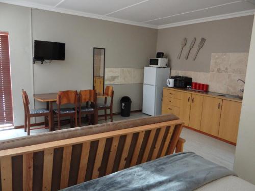 A kitchen or kitchenette at La Paix Guesthouse