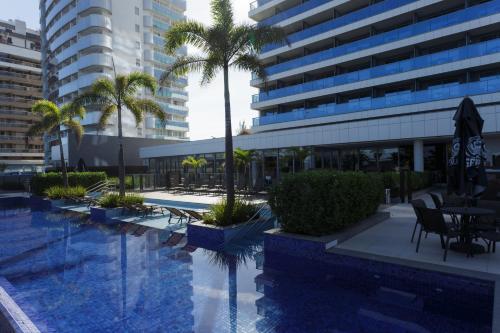 The swimming pool at or close to Laghetto Stilo Barra Rio
