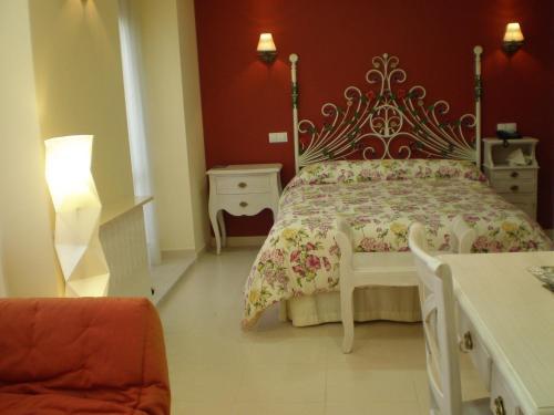 Cama o camas de una habitación en Hotel Rural La Consulta De Isar