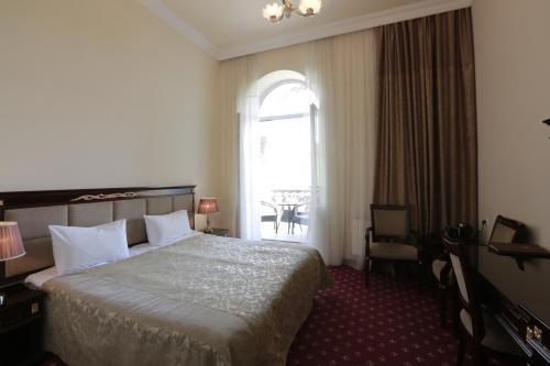 Кровать или кровати в номере Jermuk Olympia Sanatorium